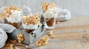 White currants and yogurt. In a glass close up Royalty Free Stock Photo