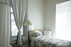 White Curtain Near Bed and Floor Lamp Stock Photos