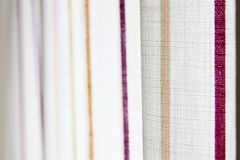 White curtain with yellow and purple stripe Royalty Free Stock Photography