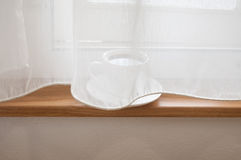 White curtains. Coffee mugs behind white curtains on the windows Stock Photography