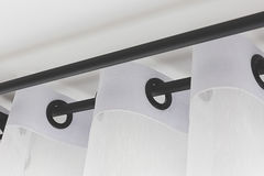 The white curtains. With ring-top rail royalty free stock photo