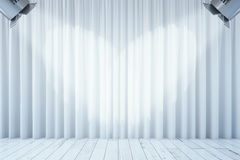 White curtains with two spotlights. Front view of empty white curtains and wooden floor with two spotlights. Stage interior. Mock up, 3D Rendering Royalty Free Stock Images