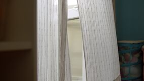 White curtains on the window in the room. The wind sways them stock video