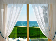 White Curtains and Window with Sea View Stock Images