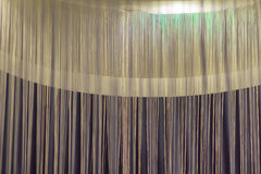 White curtains yarn against the round white lamp for lobby and l Royalty Free Stock Photos
