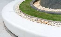 Free White Curve Stone Bench Decorated With White Gravel And Lawn. For Public Space. Stock Photo - 101469770