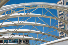 White Curved Tubular Steel Architecture Under Blue Sky Royalty Free Stock Image