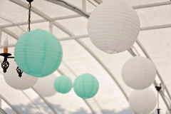 White and cyan round Chinese paper lanterns. Hanging under the ceiling Royalty Free Stock Photography