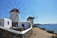 White cycladic windwill in a sunny day Royalty Free Stock Photos
