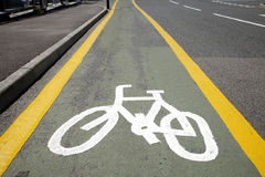 White cycle lane sign. Royalty Free Stock Photography