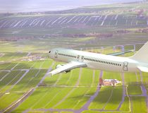 White 3D aircraft flying above landsca. White 3D aircraft flying above Dutch landsca Royalty Free Stock Image