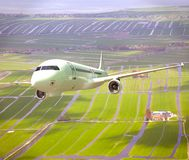 White 3D aircraft flying above landscape. White 3D aircraft flying above Dutch landscape Stock Photography