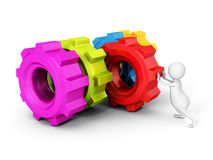 White 3d man pushing red cogwheel gear to others Stock Photo