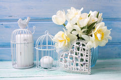 White daffodils and tulips, candles  and decorative  heart  on t Royalty Free Stock Photos