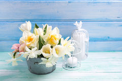 White daffodils and tulips  flowers in bucket and candles in dec Stock Images