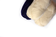 White and dark blue coils of knitting threads on a white background Royalty Free Stock Photos