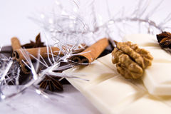 White dark chocolate with cinnamon anise walnut. Chocolate bars with spices and decoration royalty free stock image