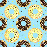White and dark chocolate donuts with blue backdrop Royalty Free Stock Photography