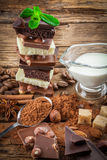 White, dark, and milk chocolate with nuts Stock Images