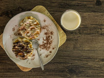 White and dark waffles with fresh warm milk Close up on wooden background.  Royalty Free Stock Photography