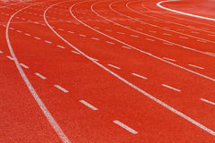 White dash line on red running track Royalty Free Stock Photos