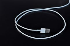 White data cable connector with USB on black background stock photos