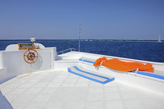 White deck blue sea. The upper deck of a yacht and a beautiful view of the blue sea and blue sky Royalty Free Stock Photography