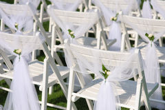 White decorated chairs on a green lawn Royalty Free Stock Photography