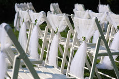 White decorated chairs on a green lawn Stock Image
