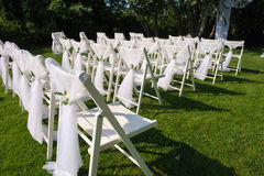 White decorated chairs on a green lawn Royalty Free Stock Photo