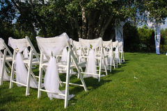 White decorated chairs on a green lawn Royalty Free Stock Image