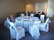 White decorated table for a wedding celebration royalty free stock images