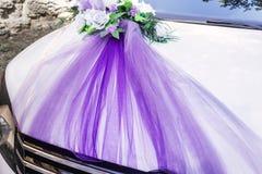 White decorated wedding car stock image