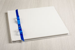 White decorated wedding guestbook on the bright table. Decorted wedding guestbook on the bright background stock image