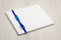 White decorated wedding guestbook on the wooden table. Decorted wedding guestbook on the bright background royalty free stock photos
