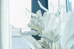 White decoration artificial flowers at window background Stock Photography