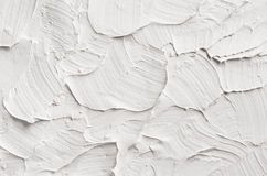 White decorative abstract plaster texture with textured smears. White decorative abstract plaster texture with textured smears Stock Photography