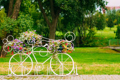 White Decorative Bicycle Parking In Garden Royalty Free Stock Photography
