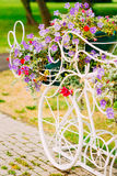White Decorative Bicycle Parking In Garden Stock Photo