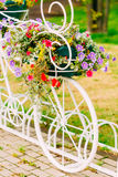White Decorative Bicycle Parking In Garden Royalty Free Stock Images