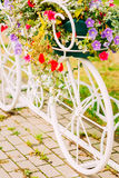 White Decorative Bicycle Parking In Garden Royalty Free Stock Photos
