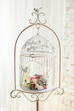 White decorative bird cage with beautiful flowers Stock Photography