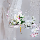 White decorative cage with beautiful flowers Stock Photos