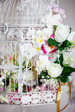 White decorative cage with beautiful flowers Royalty Free Stock Photos