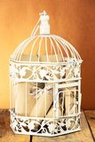 White decorative cage and bunch of rolled papers Royalty Free Stock Photo