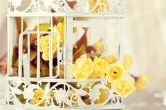 White decorative cage and flowers Stock Photos