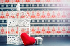 White decorative cage,gift box and red heart. Stock Images