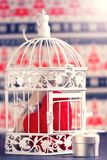 White decorative cage and gift box. Royalty Free Stock Images