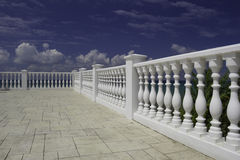 White decorative fence on the waterfront of Black sea. White decorative fence on the waterfront of the Anapa city resort on the Black Sea coast. Blue cloudy sky royalty free stock photos