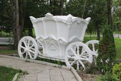 White decorative gypsum carriage. / Park or garden decoration Royalty Free Stock Photo
